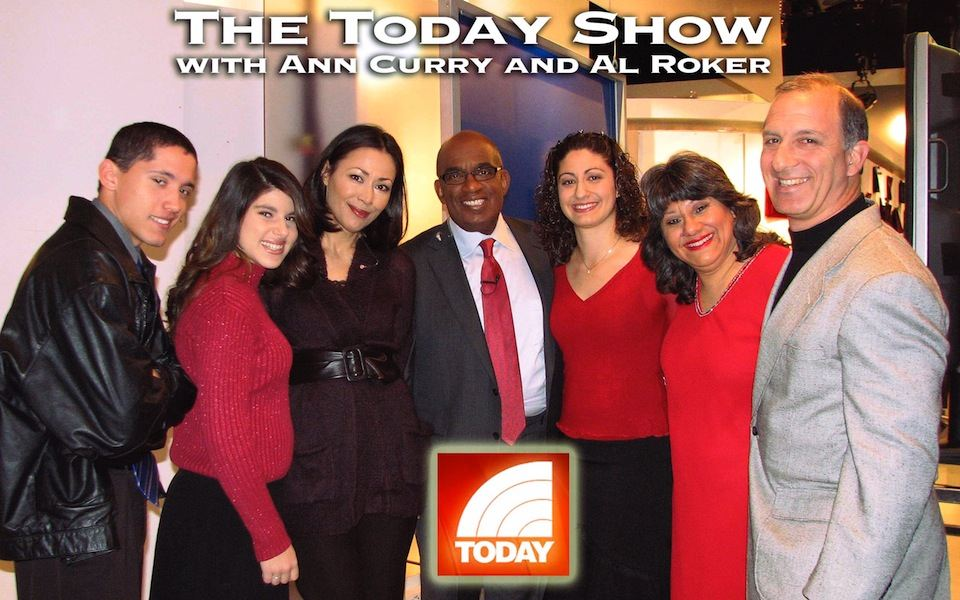 Today Show hosts, Al Roker and Ann Curry pose with the Economides Family.