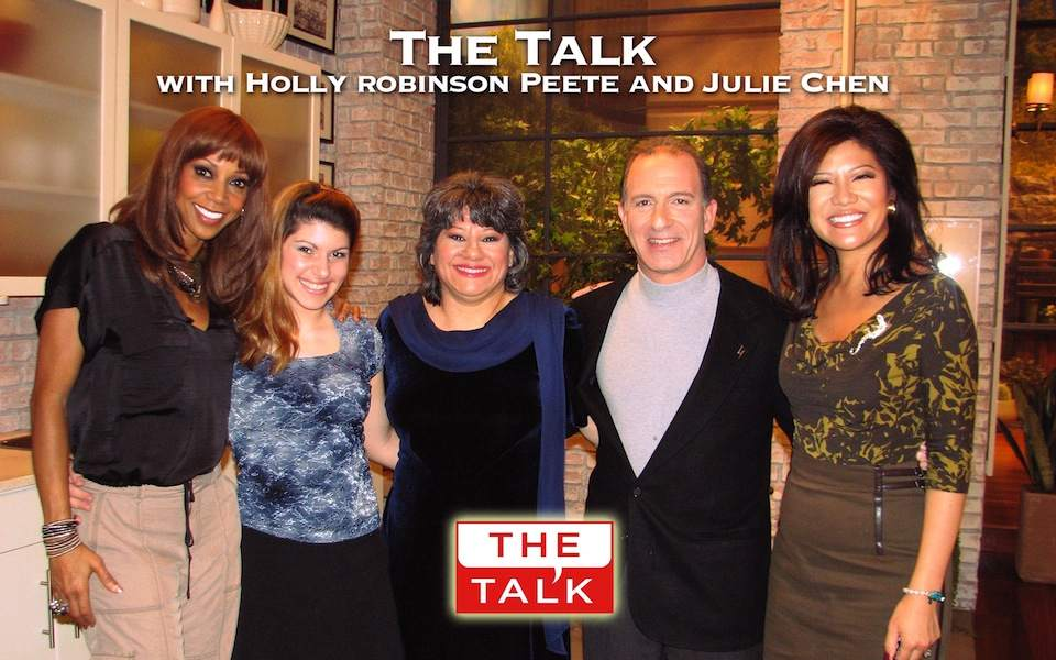 MoneySmart Family, Steve & Annette Economides, with daughter Abbey, pose with The Talk hosts Holly Robinson Peete and Julie Chen.