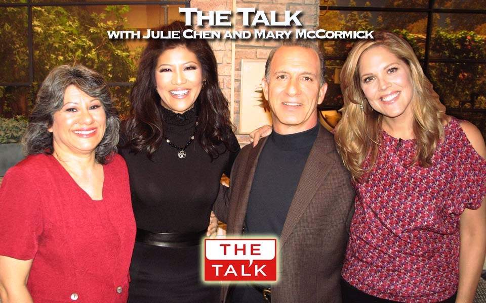 Steve & Annette Economides with Julie Chen and Mary McCormick on the set of The Talk , a CBS TV talk show.