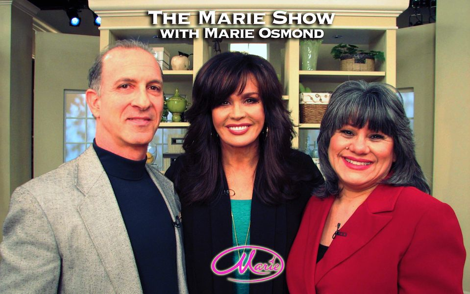 "Steve & Annette Economides from MoneySmartFamily.com, with Marie Osmond on the Hallmark Show, ""Marie."""