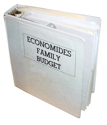 Economides Budget book binder - a white 3 ring binder with pocket folders inside is one of the best budget systems.