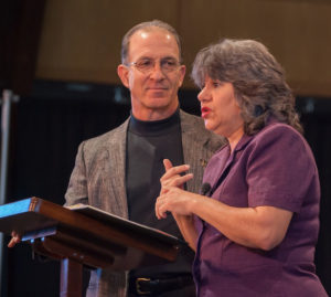 Annette & Steve Economides speaking at a convention
