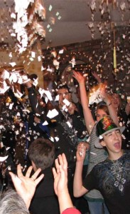 Throwing confetti on New Years Eve at the Econmides home.