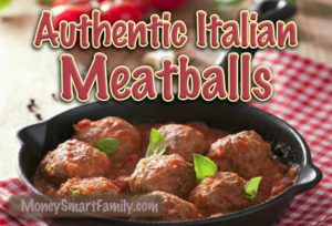 Black frying pan with italian meatballs in it