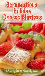 Cheese blintzes covered with red strawberries and mint.