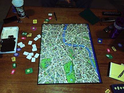Scotland Yard board game on a wooden table.