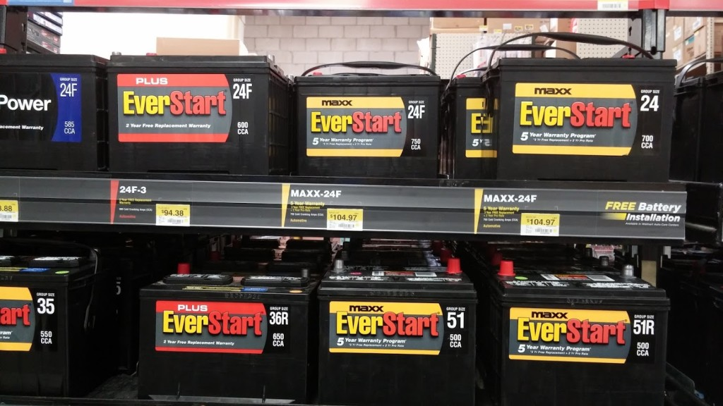 A rack holding several rows of Walmart Everstart Maxx batteries.
