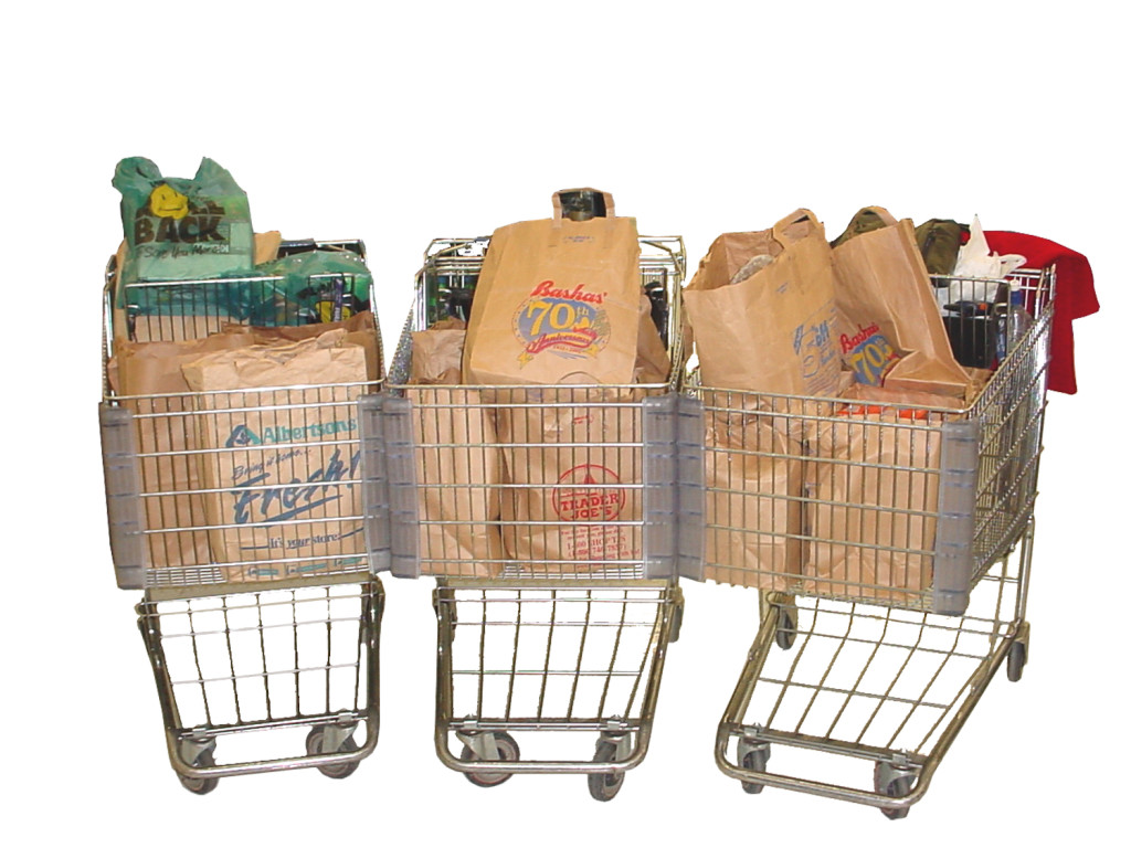 Three grocery carts full of grocery bags.