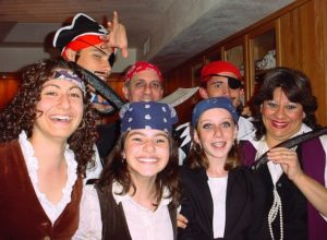 Seven people dressed up in pirate costumes.