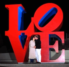 Annette & Steve Economides in front of the Love Statue