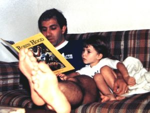 Steve Economides reading Robin Hood to his 3 year old son John.