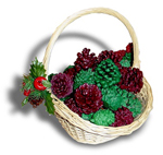 Decorative pinecone basket with green and red wax pinecone firestarters in it.