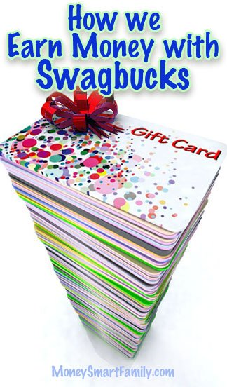 Large pile of gift cards with a red bow on top.