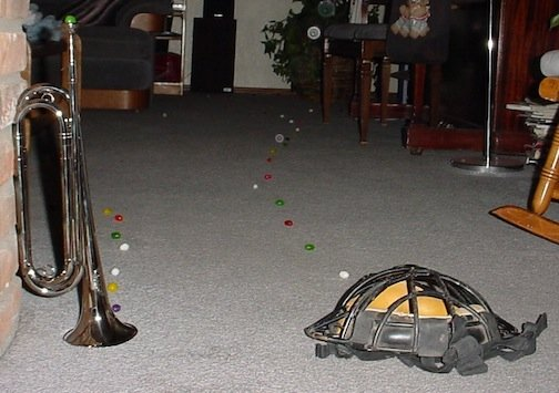 A jellybean trail started by a trumpet and a catchers mask.