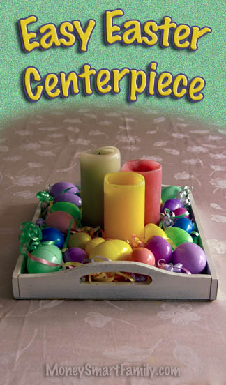 A white tray full of colored pillar candles, surrounded by colorful easter eggs and green Easter grass.