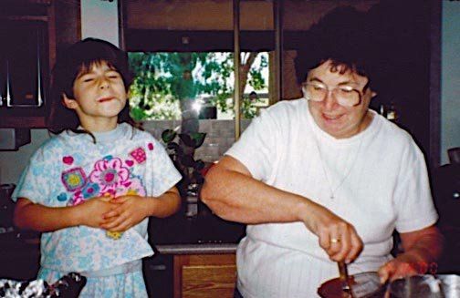 Abbey baking a cake with Nana.