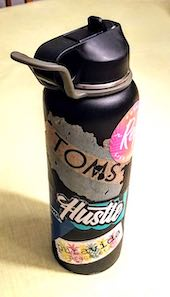 Abbey's waterbottle covered with free stickers