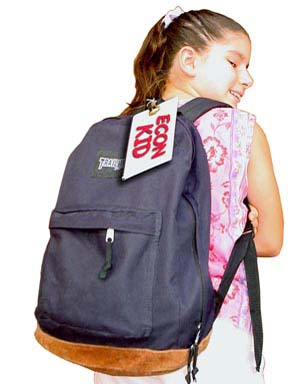 A girl wearing a black back pack with a name tag on it.