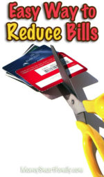 A yellow handled scissors cutting credit cards.