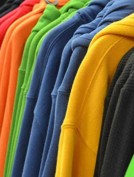 A colorful rack of new clothes.