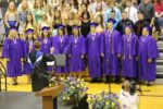 College chorus singing at a graduation ceremony.