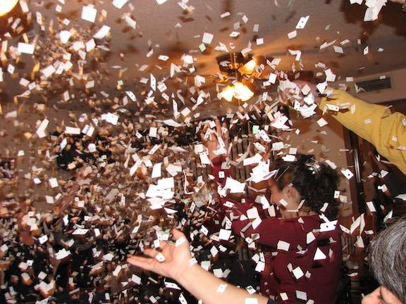 Throwing confetting on New Years Eve.