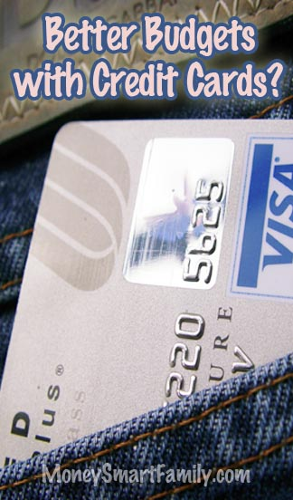 A silver and blue visa card in a blue jean pocket