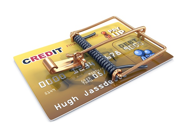 A credit card with a mouse trap built onto it to illustrate dangers of credit.