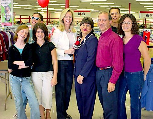 Fox10 News reporter Diane Ryan stands with the Economides Family at Savers in Phoenix, AZ.