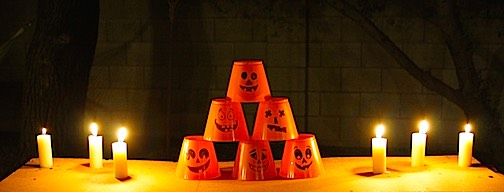 Candles and halloween cups for a squirt gun game.