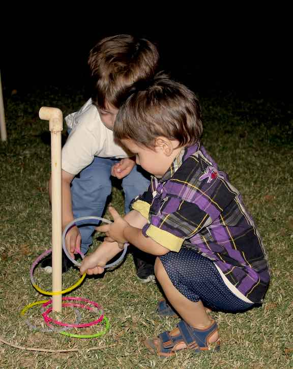 Cousins Jason and Stark play the ring game with glow stick loops.