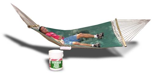 Boy laying in the hammock with a paint roller.