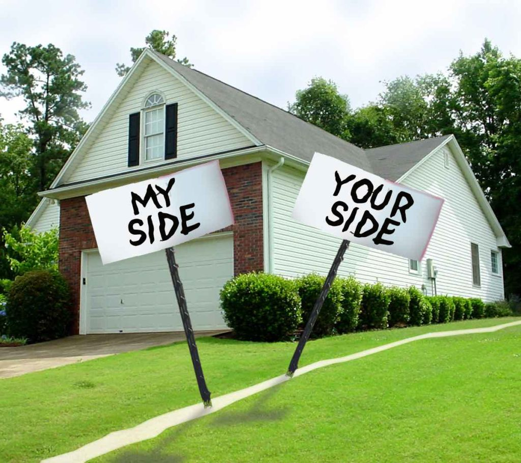 A house with a white line drawn to make the property line. With two signs saying My Side.