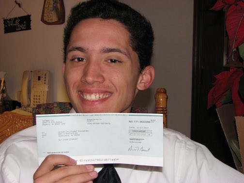 Joe's first paycheck from a job as a courtesy clerk at a grocery store.