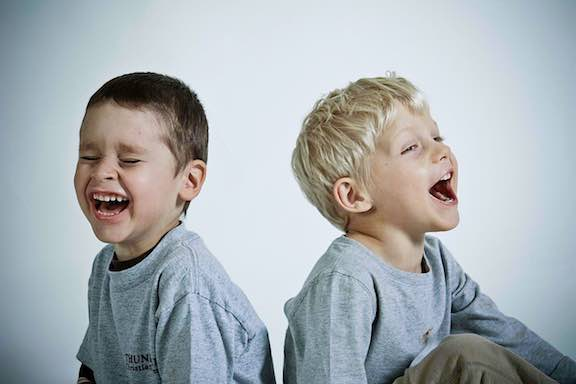 2 laughing boys.