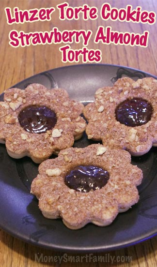 Linzer Torte Cookies on a black plate.