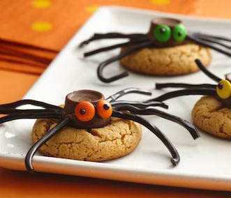 Halloween spider cookies with licorice legs.