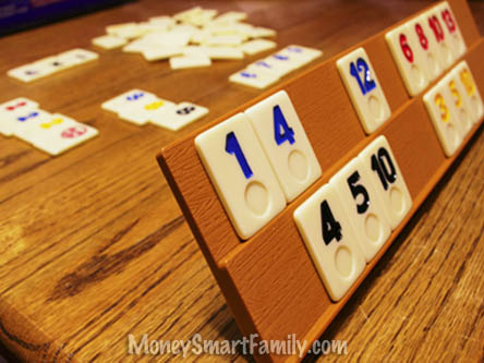 Rummy cubes number game on an oak table.