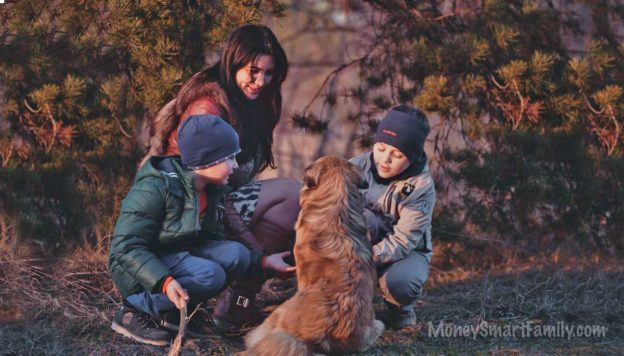 Mom with two kids and a dog in the forest. Can we live on one income?