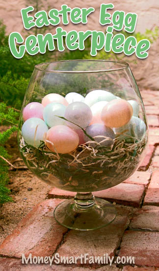 An Easter Centerpiece made with a Brandy Snifter, plastic eggs and Easter Grass, Spanish Moss or something similar.Clear Glass brandy snifter filled with Easter grass and speckled plastic Easter eggs.