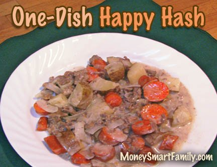 Ground beef hash served on a white plate with carrots and potatoes.