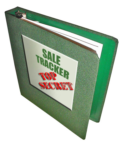 A green three ring sale tracker binder.