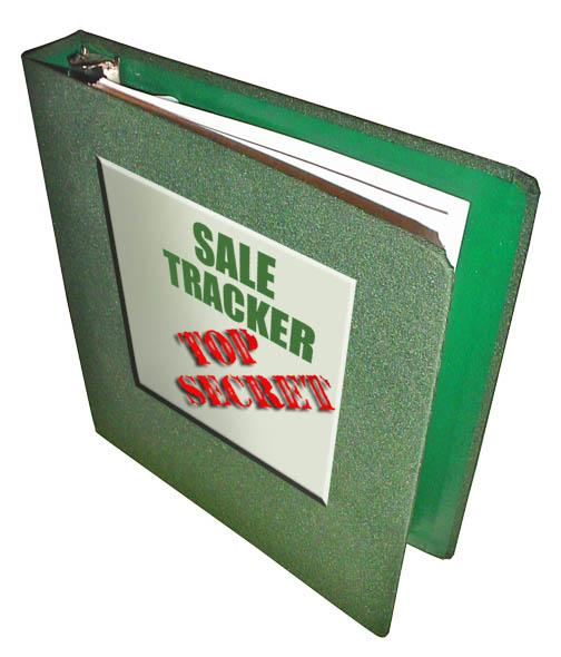 A green three ring sale tracker binder.