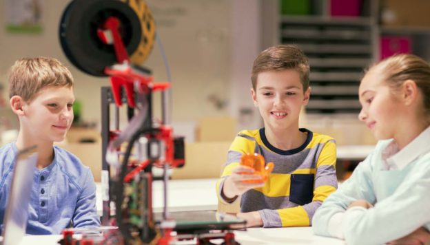 School options - three kids with a 3-d printer.