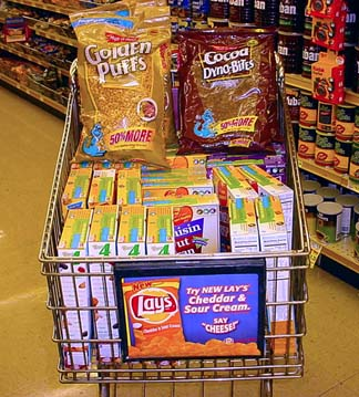 Grocery cart full of discounted cereal.