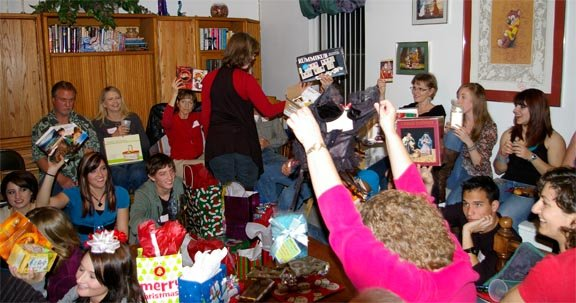 White Elephant Gift Exchange presents being held up in the air.