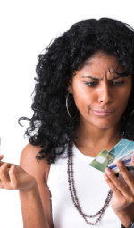 A woman with two hands full of credit cards trying to decide which one to use.