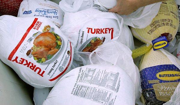 Frozen turkeys in a grocery store.