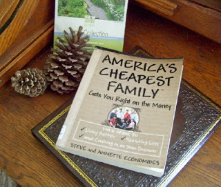 America's Cheapest Family Gets You Right on the Money Book Cover sitting on a table with two pineones.