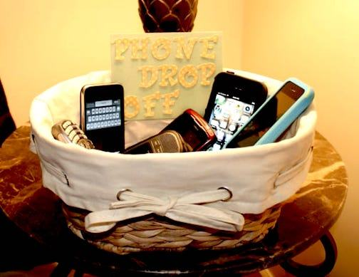 Cell phones stored in a basket from http://sarahontheblog.blogspot.com/
